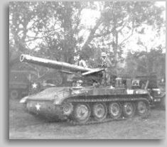 Charles Martin driving the M110 into Pleiku to set up artillery hill 54 in Nov 65 - in the background is CPL Kemple who died in action.